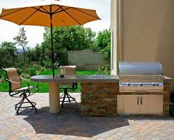 prefab outdoor kitchen with shaded dining area