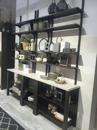 it s easy to maintain an open and airy decor when you use shelves instead of solid cabinets