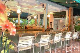 an outdoor bar at the gardens hotel in key west florida