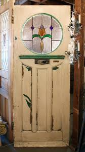 sold antique tudor door with round stained glass window early 1900 s