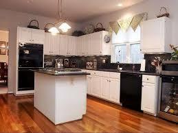 Kitchen With Black Appliances White Ceramic Tile Floor Sleek Brown ...