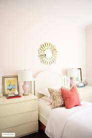 a chic modern girl s bedroom featuring blush pink walls c and brass accessories and