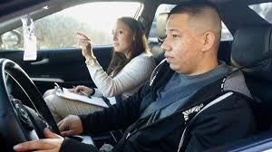 ramon maldonado takes his driving test with the arizona department of transportation motor vehicle division