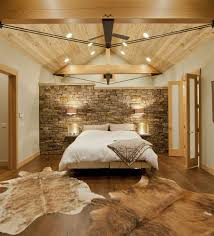 contemporary bedroom with montana limestone headboard wall and a wooden ceiling design kelly