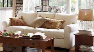 pottery barn living room with white sofa and table lamp pottery