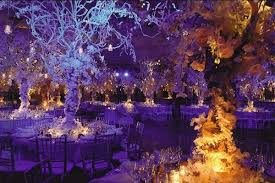 up lighting ideas. The Dramatic Centerpieces Combined With Purple Uplighting Transform This Reception Space Into A Winter Wonderland Up Lighting Ideas