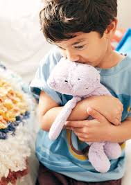Image result for child holding stuffed animal