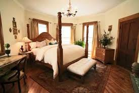 white bedroom with dark furniture. white walls and linens on dark furniture keep the room calm cool clean looking bedroom with t