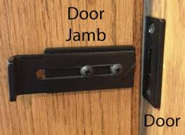 slide latch attaches to jamb and strike is attached to the door