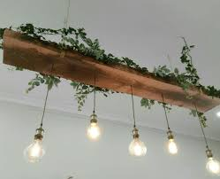 vintage looking lighting. Recycled Timber Light Feature With Vintage Looking LED Lamps And Greenery. Lighting O