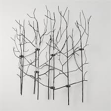 lit with votive candles this nature inspired metal wall art candle holder flickers a magical forest of shadowy branches  on nature inspired metal wall art with lit with votive candles this nature inspired wall art candleholder