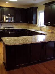 cabinet and lighting. dark and light kitchen love the color combo of cabinet countertops lighting o