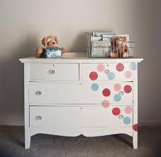 White Polka Dot Painted Wooden Dresser For Nursery Having Four ...