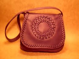 another braided leather handbag with a cicle applique on the flap the one is made