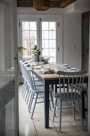 gray painted dining room table. old chatham house, remodelista, dining table gray painted room a