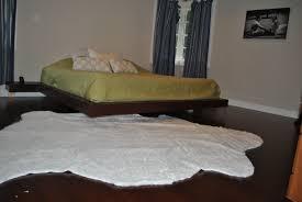 rug under bed hardwood floor. White-fur-rug-with-cozy-bed-and-wooden- Rug Under Bed Hardwood Floor