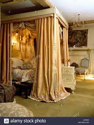 Four poster bed with silk curtains and integral lighting