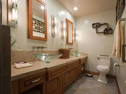 narrow bathroom with green glass vessel sinks