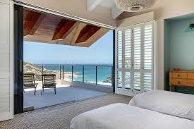 luxury beach house bedroom with sea views