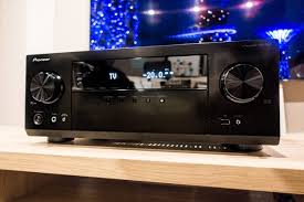pioneer vsx 832. the pioneer vsx-832 stereo receiver sitting on a wooden media cabinet. vsx 832 t