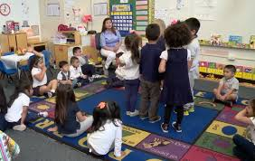 preschool teacher engaging students in early math measurement during circle time
