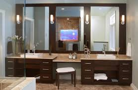 exceptional vanity lighting ideas of deep brown finish double bathroom sink cabinet with cream marble makeup table area and square stool bathroom makeup lighting