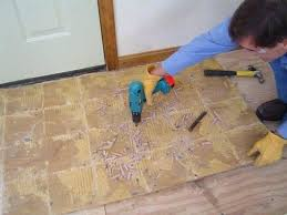 removing vinyl floor tiles from wood