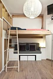duhesme small contemporary loft style bedroom idea in paris with white walls and medium tone hardwood bed for office