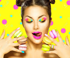 beauty fashion model with colourful makeup taking colorful macaroons stock photo 42235219