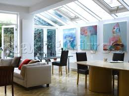 living room extension. contemporary extension open plan living room and home office area with skylight windows