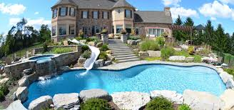 residential indoor pool with slide. Magnificent Inground Swimming Pool With Gorgeous Fountain Also Amazing Paving Stone Feat Elegant Place House Concept Residential Indoor Slide