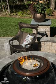 Combine the elements with a firepit surrounded by a water fixture. Eagle  Bay pavers only add to the beauty of this unique patio feature.