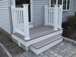 chic front porch design including wood porch floor and stone paver