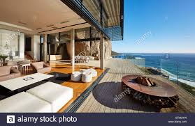 fire pit and furniture on modern luxury beach house patio with sunny ocean view interior t77 interior