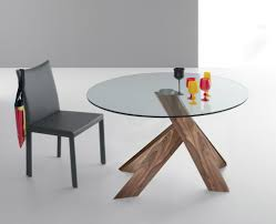 round modern stretched glass top dining table feature wood base with teak wood together black leather