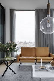 Mid-Century Inspired Apartment in Lozenetz, Bulgaria. Layered light gray  curtains with sheers on double track.