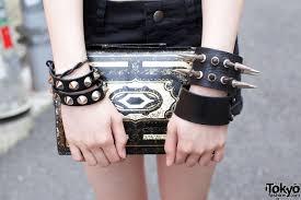 spikes studs and vintage leather clutch