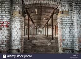 Abandoned Victorian warehouse interior with rusting iron pillars