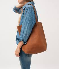 have you seen baggu s soft leather tote bags they ve been blowing up on the internet it s surprisingly hard to find lovely simple bags but these are the