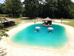 small backyard swimming pool cost inground ideas above ground want a beach in your this man can make dreams come true inspiring z