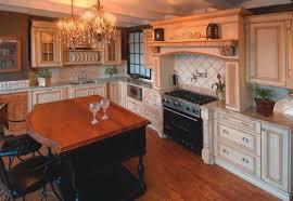 ornate kitchen custom hood cream cabinet with glaze black island wood top