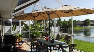 tan triple vent market patio umbrella