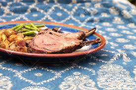 Rack Of Lamb With Roasted Golden Baby Potatoes Seasoned With Stock
