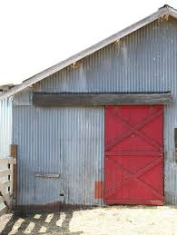 above a 100 year old farm in central california boasts a barn clad in corrugated siding and a barn door painted lipstick red for more see california