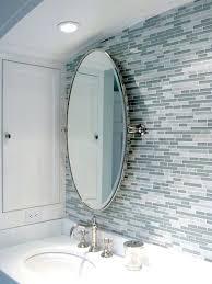 linear backsplash tiles ideas bathrooms blue gray linear glass mosaic tiles oval pivot mirror modern contemporary