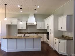 knotty alder kitchen cabinets after being refinished in white