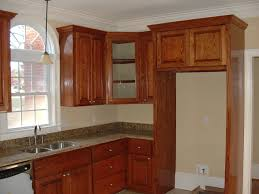 Kitchen Upper Cabinets With Darker Stained Cabinet Crown Molding Ideas