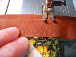 Quilt Binding - Lynn Carson Harris & Remove the quilt from under the presser foot and fold the binding strip  back so that the right edges are even. Adamdwight.com