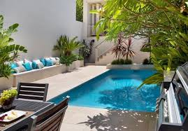 swimming pool: Charming Blue And White Colored Pillows Placed On Concrete  Sofa Mixed With Small