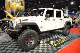 2011 white jeep wrangler 4 door with a custom pickup bed by justin behrends